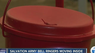 Salvation army bell ringers moving inside - Video