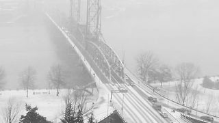 Timelapse Shows Traffic Over Snow Covered Bridge in Portland - Video