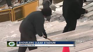 Shovelers clear Lambeau Field of snow - Video