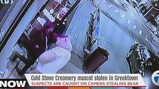 Two people caught on camera taking a large teddy bear
