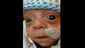 Newborn baby caught smiling for first time - Video