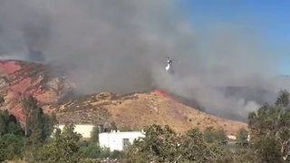 Air Tankers Drop Water on Growing Mart Fire in Highland - Video