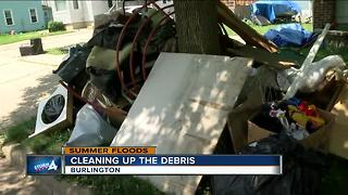 Crews cleanup flood debris in Burlington - Video
