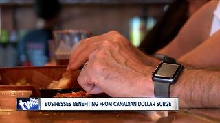 Local businesses see boom under improved Canadian dollar - Video