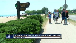 Beachgoers cautiously return to Bradford after shooting - Video