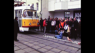 Man Pulls Tram With Hair - Video