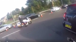 Learner Driver Gets Helping Hand From Police in Heavy Traffic - Video