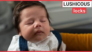 Baby born with marvellous head of thick black hair