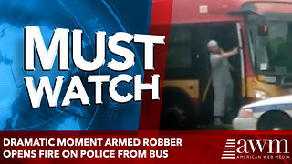 Dramatic moment armed robber opens fire on police from bus - Video