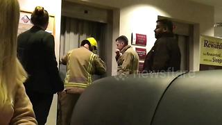 Firefighters rescue coworkers stuck in lift before Christmas party - Video