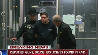 Deputies: Guns, drugs, explosives found in raid - Video