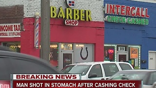 Man shot in stomach after cashing check in Indianapolis - Video