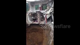 Woman missing after sinkhole opens under house in China - Video