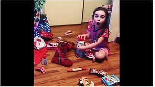 Little girl absolutely thrilled to receive Parmesan cheese for Christmas! - Video