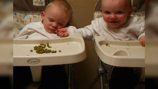 Twin Baby Shares Food With Sleepy Brother - Video