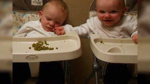 Twin Baby Shares Food With Sleepy Brother