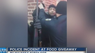 Food giveaway turns into police incident on Milwaukee's north side - Video