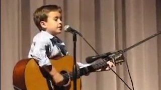 Boy Masters Guitar During Johnny Cash Cover Performance