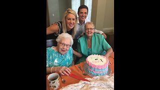 Great-grandmother cuts cake for emotional baby gender reveal