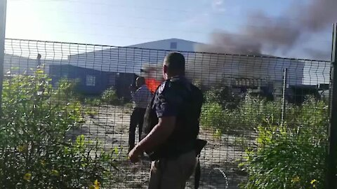 SOUTH AFRICA - Cape Town - Happy Valley protesters burning factory in Blackheath (H6H)