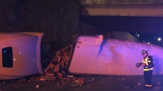 No one injured after semi veers off overpass - Video