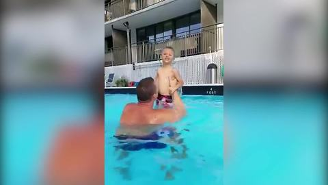 Tot Boy Loses His Swimming Trunks In A Pool