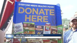 Food drive held at Packers game before kick-off - Video