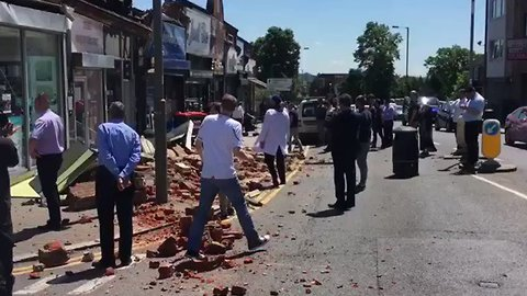 Shoppers Helped to Safety After Roof Collapses on North London Street