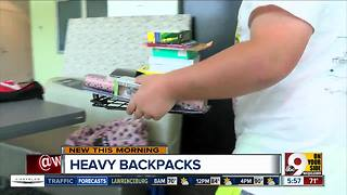 The dangers of your kids' heavy backpacks - Video