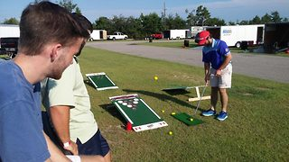 Beer pong golf encourages players to chip their way to getting their opponents drunk