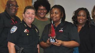 West Palm Beach police dispatcher honored - Video