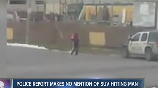 Police report makes no mention of SUV hitting a man - Video
