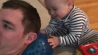 Baby Pulls Innocent Prank On Dad, Giggles Uncontrollably - Video