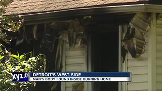 Man's body found inside burning home