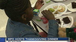 MPD officers hosts Thanksgiving dinner - Video