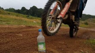 Bottle Cap Challenge executed on a motorcycle