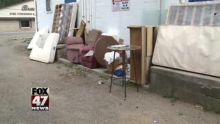 Non-profit fed up with people dumping trash behind building - Video