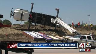 Crane topples onto 7 Highway in Blue Springs - Video