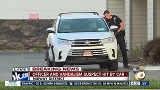 SDPD officer hospitalized after being struck by SUV in Midway District