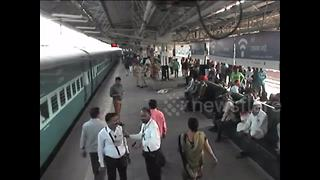 Alert railway official saves passenger from slipping under train - Video
