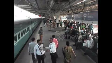 Alert railway official saves passenger from slipping under train