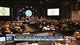 Funeral underway for the two car crash victims - Video