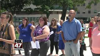 Michigan residents rally against cutting housing funds - Video