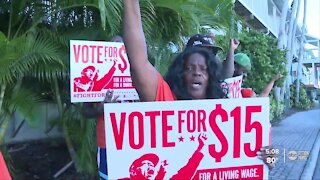 Low-income workers celebrating Florida's minimum wage hike