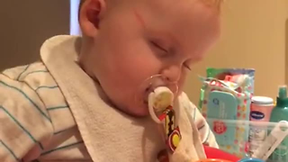 Overtired Baby Goes To Sleep Mode When On Feeding Chair - Video