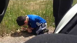 Poor Kid Isn't Able to Cope With Winding Italian Roads - Video