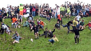Annual Cheese Rolling Competition In Gloucestershire