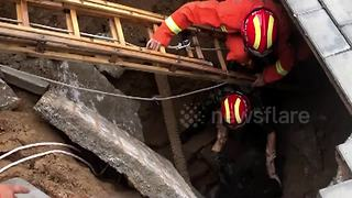 Firefighters rescue woman trapped in sinkhole