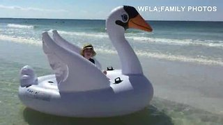Mom and sun drift away on giant inflatable swan