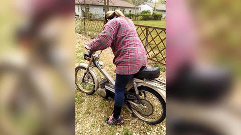 Woman Crashes A Motorcycle Into A Fence